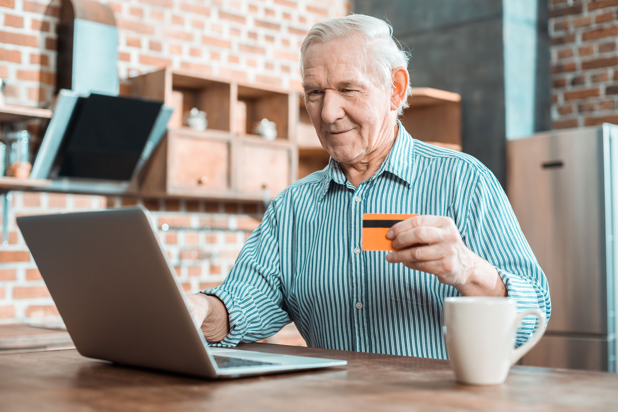 Elderly man using healthcare technology